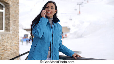 Attractive young woman at a mountain ski resort