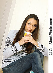 Attractive young woman at home