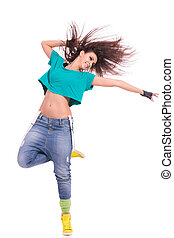 attractive young woman dancer posing on white background. she is standing on one foot and extending a hand to her side