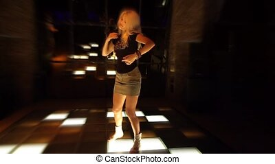 Attractive young woman dancing in a nightclub