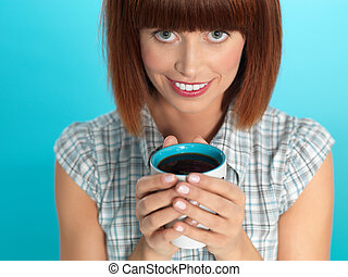 attractive young woman drinking her morning coffee -...