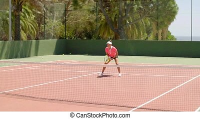 Attractive young woman enjoying a game of tennis