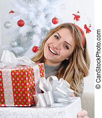 attractive young woman giving you gifts for Christmas