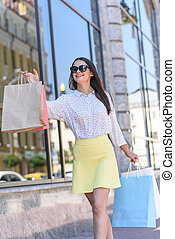 Attractive young woman going shopping