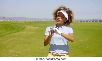 Attractive young woman golfer on a golf course - Attractive...