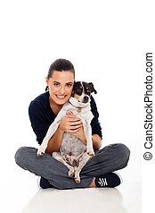 attractive young woman holding her dog isolated on white...