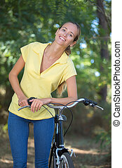 attractive young woman in a bike