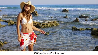 Attractive young woman in a bikini and sarong
