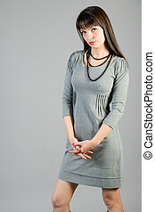 young woman in a gray dress
