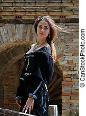 Attractive young woman in a medieval dress