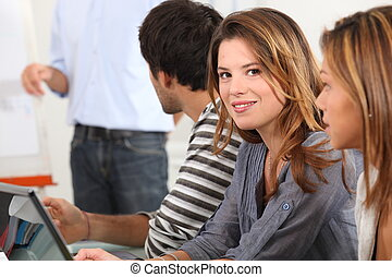 Attractive young woman in a meeting