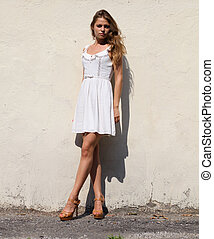Attractive young woman in a sexual dress