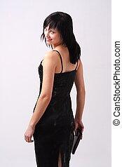 woman in black dress with handbag