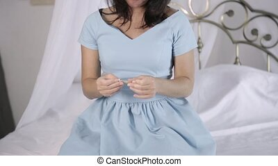 attractive young woman in blue dress have a good time in bed