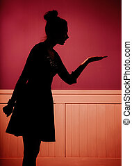 Attractive young woman in dark room