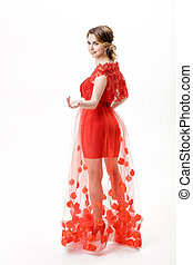 attractive young woman in evening red dress on white background