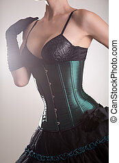 Attractive young woman in green corset