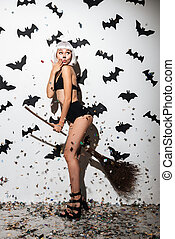 Attractive young woman in halloween costume cat