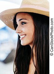 Attractive young woman in hat