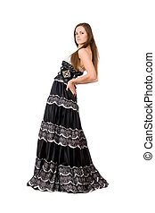 Attractive young woman in long dress
