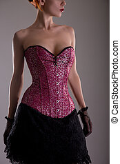 Attractive young woman in purple corset