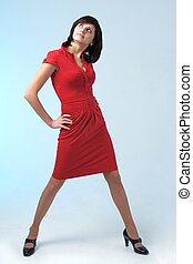Attractive young woman in red dress