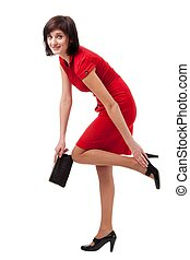 Attractive young woman in red dress with handbag