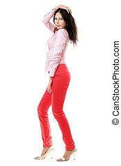 Attractive young woman in red jeans