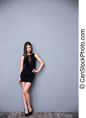 Attractive young woman in sexy black dress