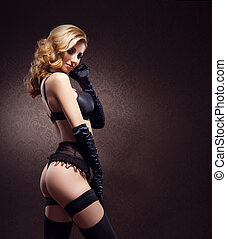 Attractive young woman in sexy lingerie over vintage...