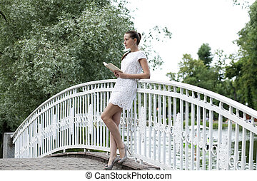 Attractive young woman in white dress