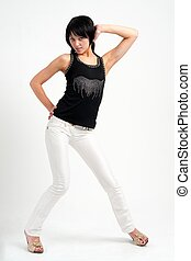 Attractive young woman in white jeans