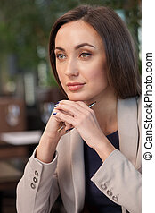 Attractive young woman is resting in restaurant