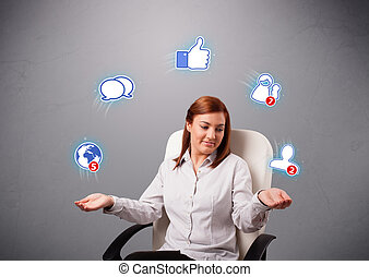 attractive young woman juggling with social network icons