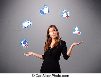 attractive young woman juggling with social network icons -...