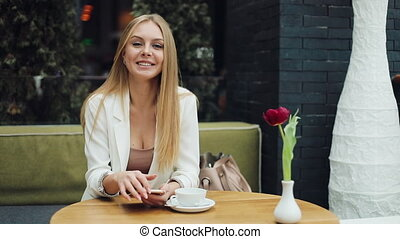 Attractive young woman look ar camera smiling feel happy in mall close up shopaholic fashion clothing girl shopping money lifestyle store portrait weekend shop slow motion