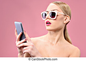 Attractive young woman looking at mobile screen