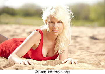 Attractive young woman lying on the beach