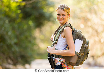 young woman mountain climbing - attractive young woman...