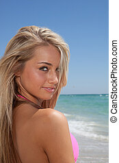 Attractive young woman on a beach