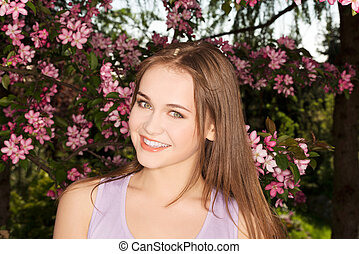 Attractive young woman outdoor view.