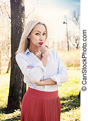 Attractive young woman, outdoors portrait