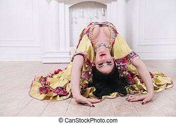 attractive young woman performing passionate Gypsy dance