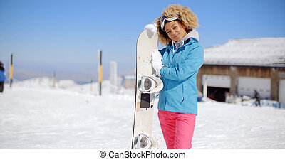 Attractive young woman posing at a ski resort