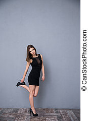 Attractive young woman posing in black dress