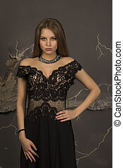 Attractive young woman posing in dress