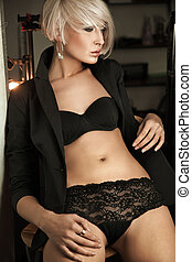 Attractive young woman posing in lingerie