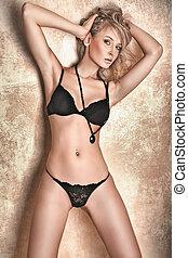 Attractive young woman posing in underwear
