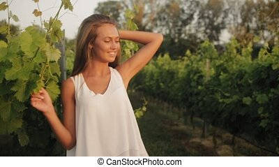 Attractive young woman posing in vineyards