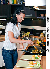 Attractive young woman preparing lunch